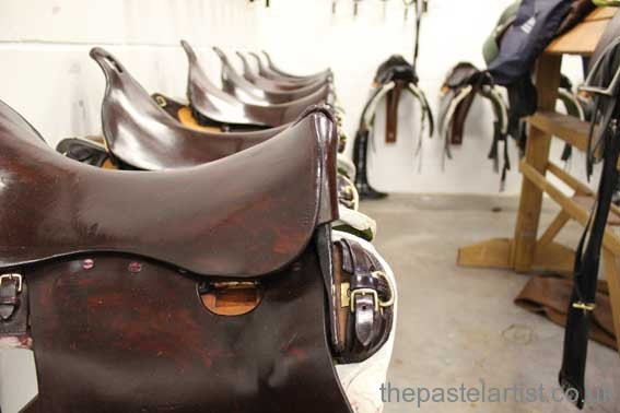 The King's Troop Royal Horse Artillery - saddles in lines with highly polished leather.